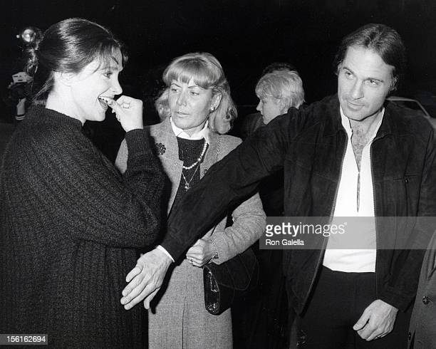Actress Connie Sellecca and actor Gil Gerard attending 'Rolls Royce Unveiling New Cars' on April 1 1981 at Sidney Sheldon's home in Los Angeles...