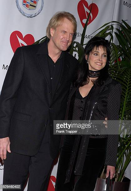 Actress Connie Sellecca and Emmyaward winning musician John Tesh arrive at MusiCares Person of the Year tribute to musician and composer Brian Wilson...