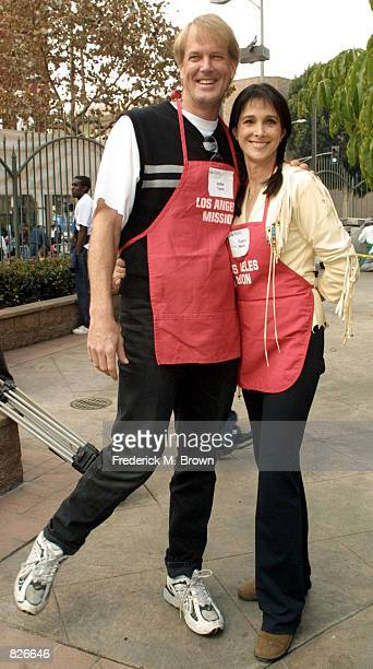 Actress Connie Sellecca and her husband John Tesh attend the Thanksgiving Day Meal for the homeless at the Los Angeles Mission November 21 2001 in...