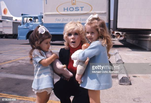 Actress Connie Stevens attends an event with her daughters Joely Fisher and Tricia Leigh Fisher in circa 1970
