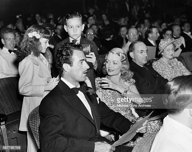 Actress Constance Bennett and her husband actor Gilbert Roland and his children attend an event in Los Angeles California