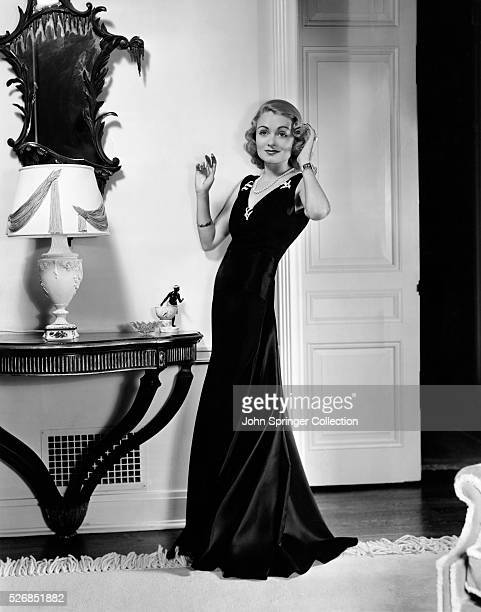 https://media.gettyimages.com/photos/actress-constance-bennett-modeling-an-evening-gown-picture-id526851882?s=612x612