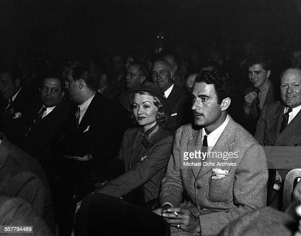 Actress Constance Bennett with her husband actor Gilbert Roland attend an event in Los Angeles California