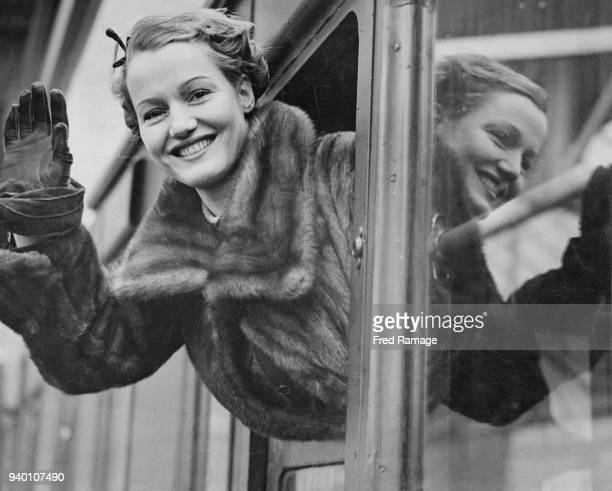 Actress Constance Cummings leaves Waterloo Station in London on the 'Queen Mary' boat train bound for New York to appear in the play 'The Young Madam...