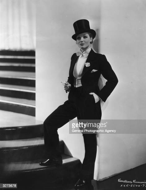 Actress Constance Cummings wearing a man's suit for the film 'Broadway Thru A Keyhole', a low-budget gangster drama directed by Lowell Sherman for...