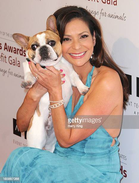 Actress Constance Marie and Beatrice the dog attend The Humane Society's 2013 Genesis Awards benefit gala at the Beverly Hilton Hotel on March 23,...