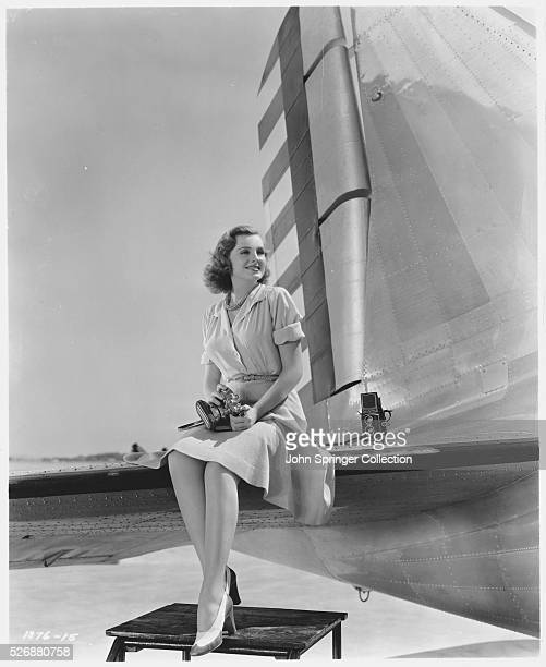 Actress Constance Moore Sitting on Plane's Tail Fin