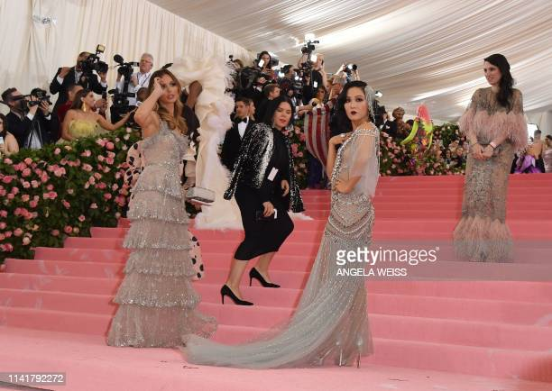US actress Constance Wu and English designer Georgina Chapman arrive for the 2019 Met Gala at the Metropolitan Museum of Art on May 6 in New York The...