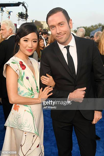 Actress Constance Wu and Kit Williamson attend The 22nd Annual Critics' Choice Awards at Barker Hangar on December 11 2016 in Santa Monica California