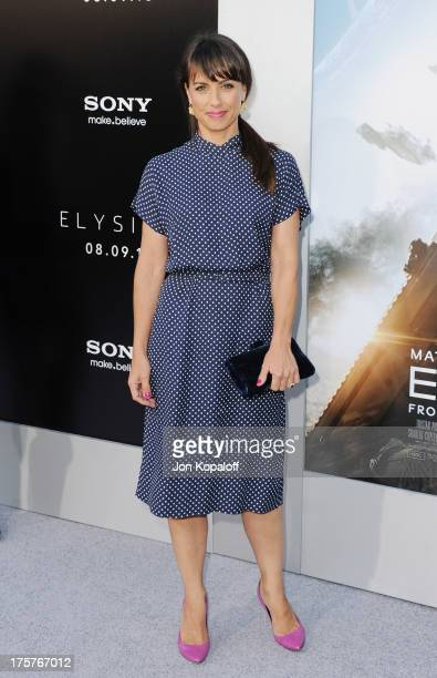 Actress Constance Zimmer arrives at the Los Angeles Premiere 'Elysium' at Regency Village Theatre on August 7 2013 in Westwood California