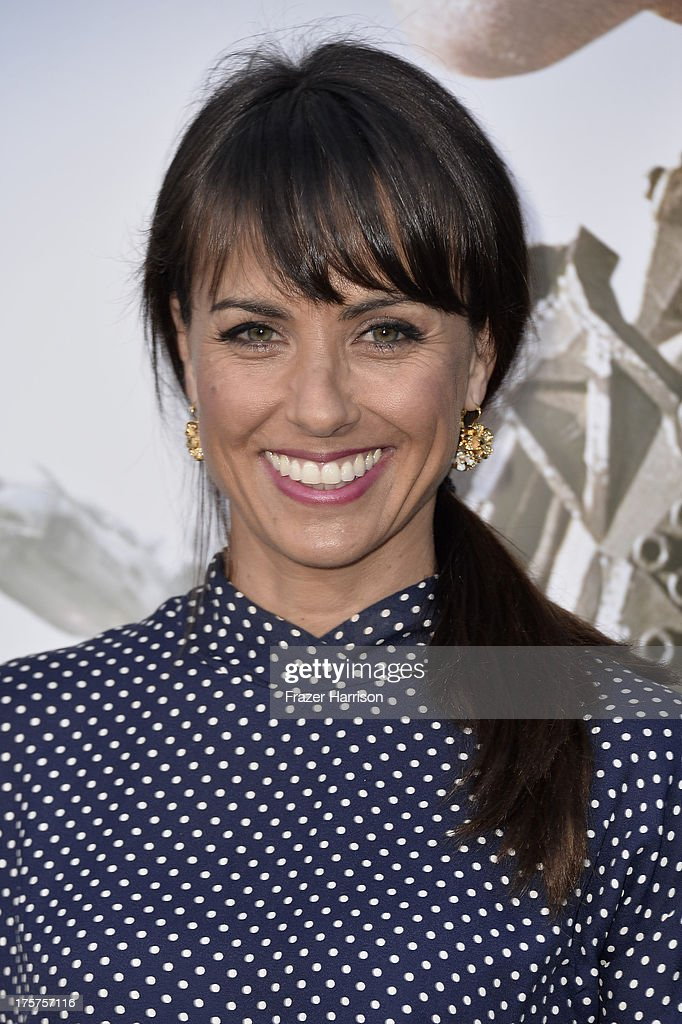 Actress Constance Zimmer arrives at the premiere of TriStar Pictures' 'Elysium' at Regency Village Theatre on August 7, 2013 in Westwood, California.