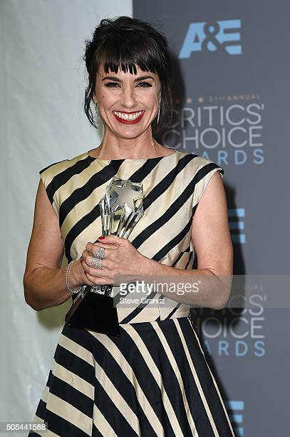 """Actress Constance Zimmer, winner of the award for Best Supporting Actress in a Drama Series for """"Unreal,"""" poses in the press room during the 21st..."""