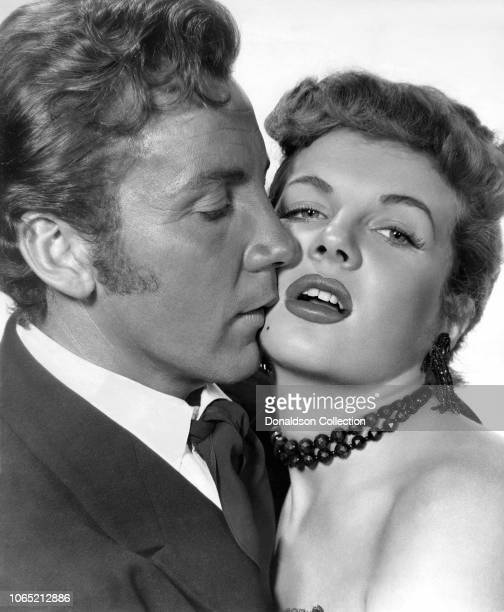 Actress Corinne Calvet and Cameron Mitchell in a scene from the movie Powder River