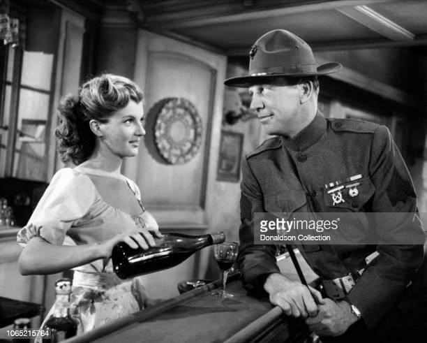 Actress Corinne Calvet and Dan Dailey in a scene from the movie What Price Glory