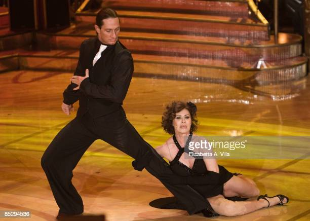 Actress Corinne Clery and her dance partner Chuck Danza perform during the tv show Strictly Come Dancing on March 7 2009 in Rome Italy