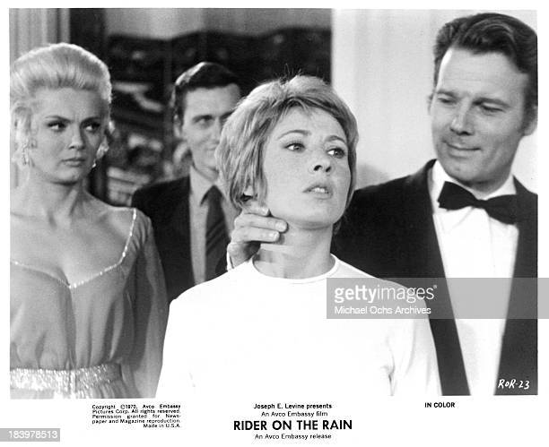 Actress Corinne Marchand actress Marlene Jobert and actor Gabriele Tinti on set of the Embassy Pictures movie 'Rider on the Rain' in 1970