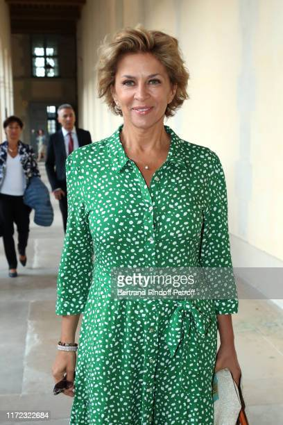 """Actress Corinne Touzet attends the """"Tosca - Opera en Plein Air"""" performance at Les Invalides on September 04, 2019 in Paris, France."""
