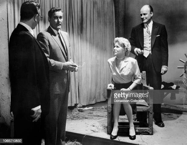 """Actress Cornell Borchers and Errol Flynn with Werner Klemperer in a scene from the movie """"Istanbul"""""""