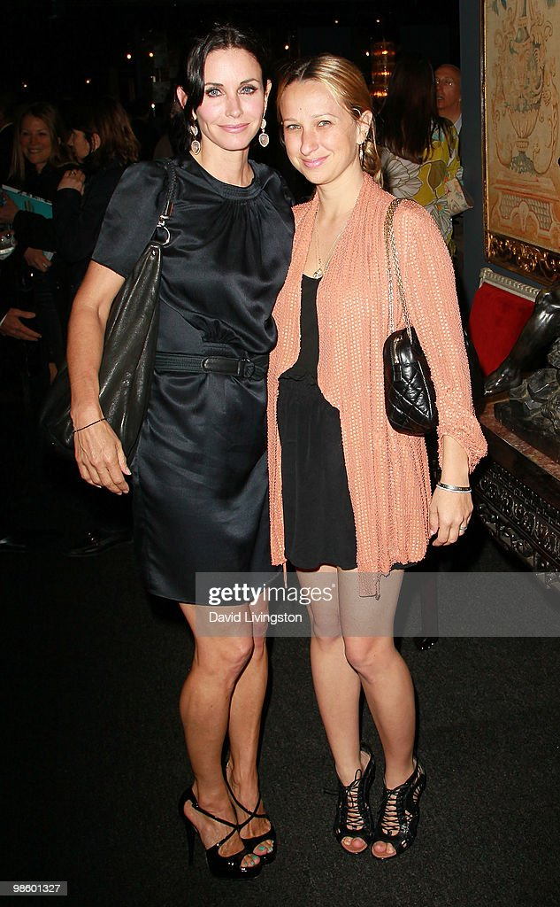 Actress Courteney Cox and Jennifer Meyer-Maguire attend the 15th Annual Los Angeles Antique Show Opening Night Preview Party benefiting P.S. ARTS at Barker Hanger on April 21, 2010 in Santa Monica, California.