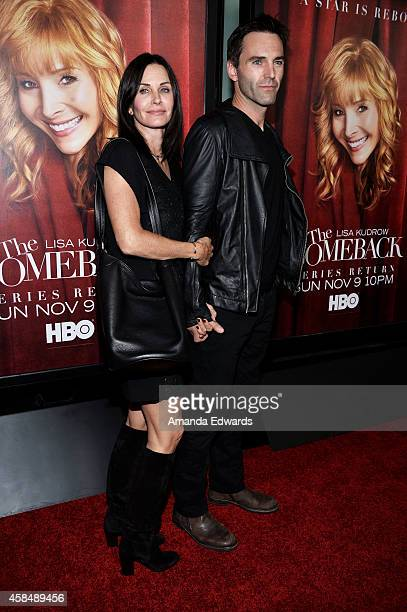 Actress Courteney Cox and musician Johnny McDaid arrive at the Los Angeles premiere of HBO's series 'The Comeback' at the El Capitan Theatre on...
