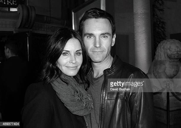 Actress Courteney Cox and musician Johnny McDaid attend the Los Angeles premiere of New Line Cinema's 'Horrible Bosses 2' at TCL Chinese Theatre on...