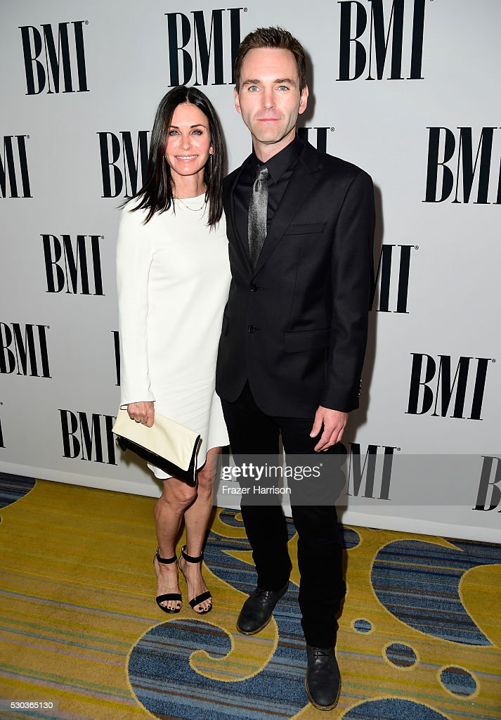 Actress Courteney Cox (L) and musician Johnny McDaid of Snow Patrol attend The 64th Annual BMI Pop Awards, honoring Taylor Swift and songwriting duo Mann & Weil, at the Beverly Wilshire Four Seasons Hotel on May 10, 2016 in Beverly Hills, California.
