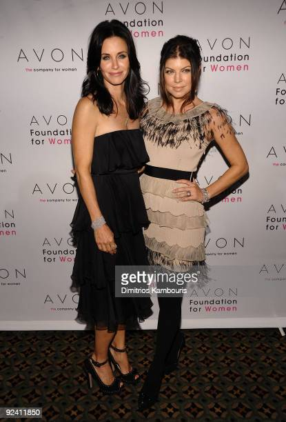 Actress Courteney Cox and singer Fergie walk the red carpet during the 'Champions Who Change Women's Lives' celebration at Cipriani 42nd Street on...
