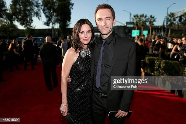 Actress Courteney Cox and songwriter Johnny McDaid attend The 57th Annual GRAMMY Awards at the STAPLES Center on February 8 2015 in Los Angeles...