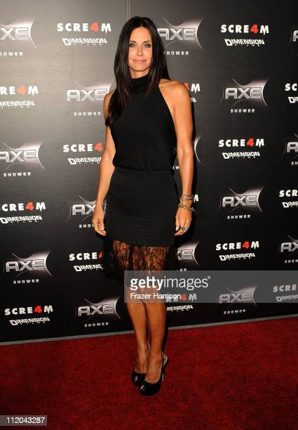 Actress Courteney Cox arrives at the premiere of the Weinstein Company's Scream 4 Presented by AXE Shower at Grauman's Chinese Theatre on April 11...
