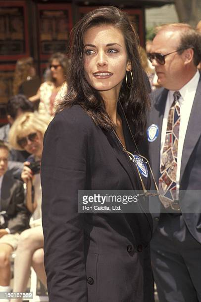 Actress Courteney Cox attends Michael Keaton's Hands and Footprints in Cement Ceremony on June 15 1992 at Mann's Chinese Theatre in Hollywood...