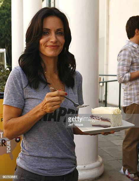 Actress Courteney Cox attends the kick off for Hunger Action Month with Feeding America and The Cheesecake Factory hosted by David Arquette at Culver...