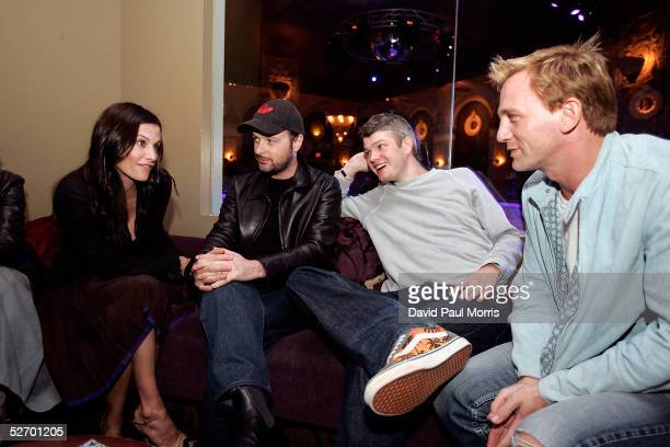 Actress Courteney Cox Director Matthew Vaughn unidentified man and actor Daniel Craig enjoy a conversation during the after party at the Ruby Sky...