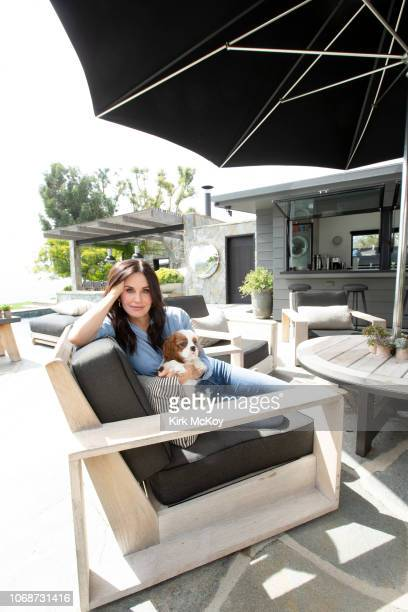 Actress Courteney Cox is photographed with dog for Los Angeles Times on October 13 2018 at home in Malibu California PUBLISHED IMAGE CREDIT MUST READ...