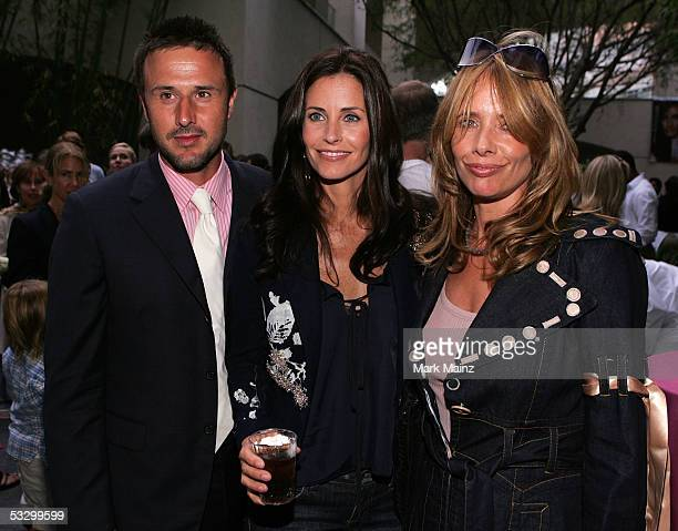 Actress Courteney Cox poses with her husband actor David Arquette and her sisterinlaw actress Rosanna Arquette at the EB Medical Research Foundation...