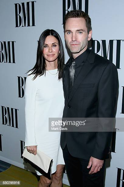 Actress Courtney Cox and musician Johnny McDaid of Snow Patrol attend the 64th Annual BMI Pop Awards held at the Beverly Wilshire Four Seasons Hotel...