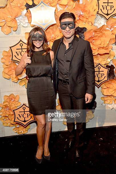 Actress Courtney Laine Mazza and television host Mario López at The UNICEF Dia de los Muertos Black White Masquerade Ball at Hollywood Forever...