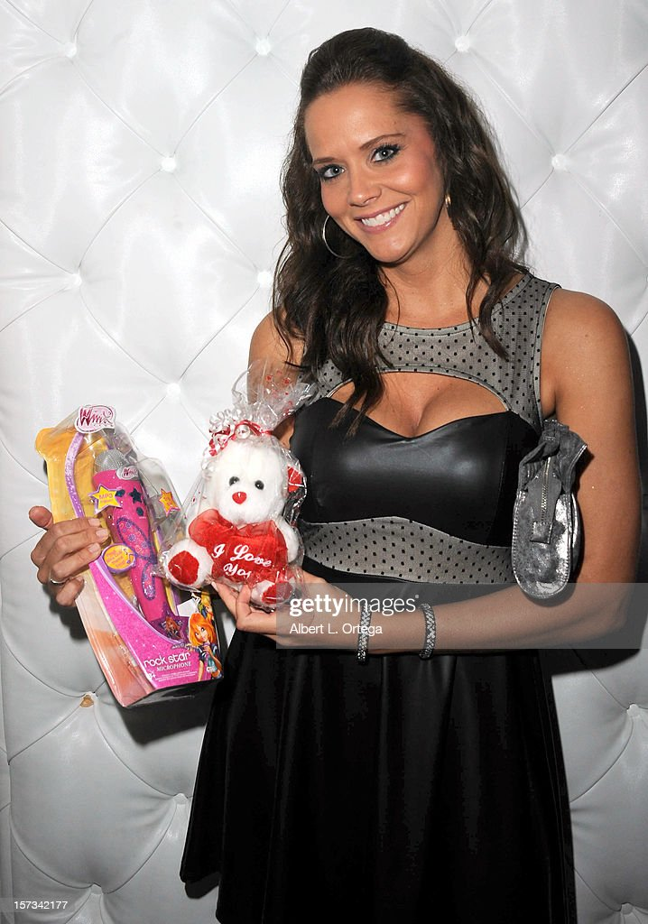 Actress Courtney Moore arrives for the 5th Annual Babes In Toyland Charity Toy Drive to benefit Los Angeles County Sheriff's Department Toy Drive held at Confidential on December 1, 2012 in Beverly Hills, California.
