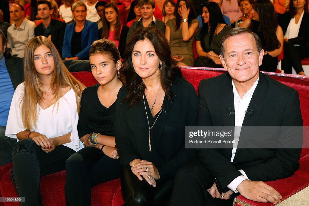 Actress Cristana Reali (2nd R), main guest of the show actor Francis Huster (R) with their daughters Elisa (L) and Toscane (2nd L) attend the 'Vivement Dimanche' French TV Show at Pavillon Gabriel on September 24, 2014 in Paris, France.