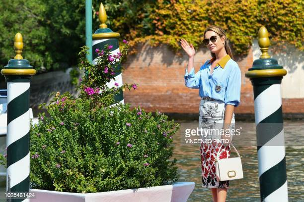 Actress Cristiana Capotondi waves as she arrives at the Excelsior Hotel on August 31 2018 during the 75th Venice Film Festival at Venice Lido