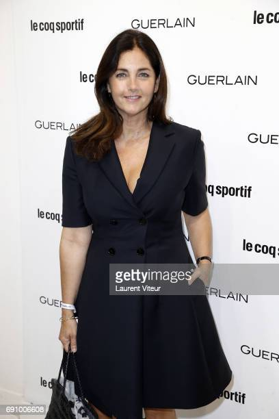 """Actress Cristiana Reali attends """"Le Coq Sportif x Guerlain"""" at Le Coq Sportif Flagship on May 31, 2017 in Paris, France."""