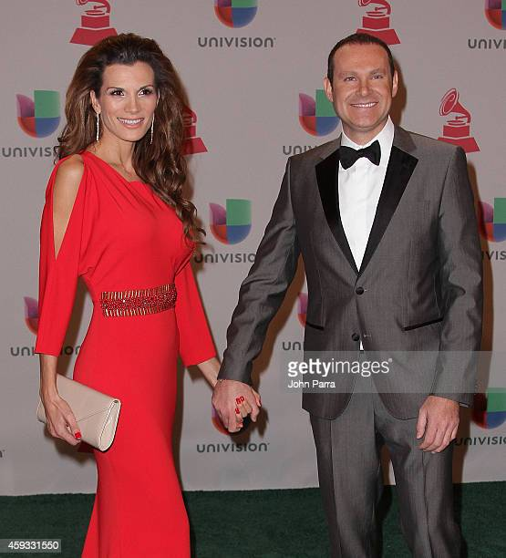 Actress Cristina Bernal and TV host Alan Tacher attend the 15th annual Latin GRAMMY Awards at the MGM Grand Garden Arena on November 20 2014 in Las...