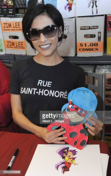 Actress Cristina Vee with Ladybug cosplayer Jen participate at The Miraculous Ladybug toy and comic signing held at Golden Apple Comics on July 16...