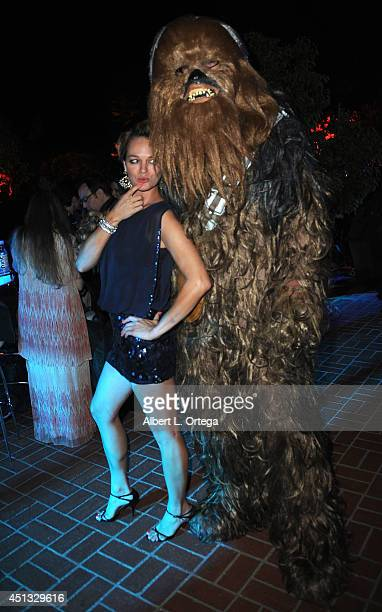 Actress Crystal Allen poses with Chewbacca at the After Party for the 40th Annual Saturn Awards held at on June 26 2014 in Burbank California