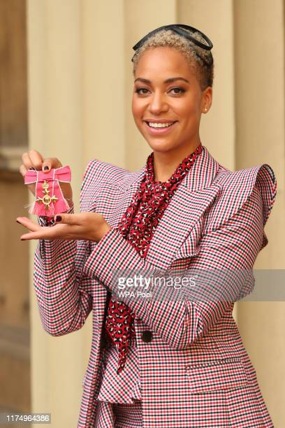 Actress Cush Jumbo holding her OBE during an investiture ceremony at Buckingham Palace on October 10 2019 in London England