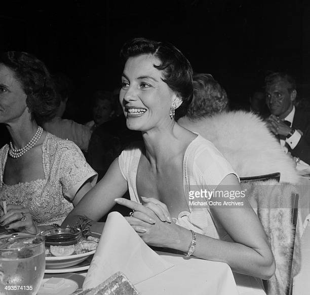 Actress Cyd Charisse with her husband Tony Martin attend the Friars Dinner in Los Angeles California