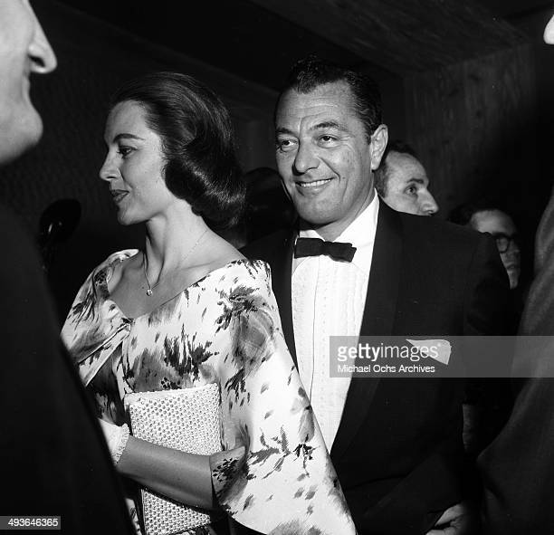 LOS ANGELES CALFORNIA FEBRUARY 14 1957 Actress Cyd Charisse with her husband Tony Martin attend the Friars dinner party in Los Angeles California