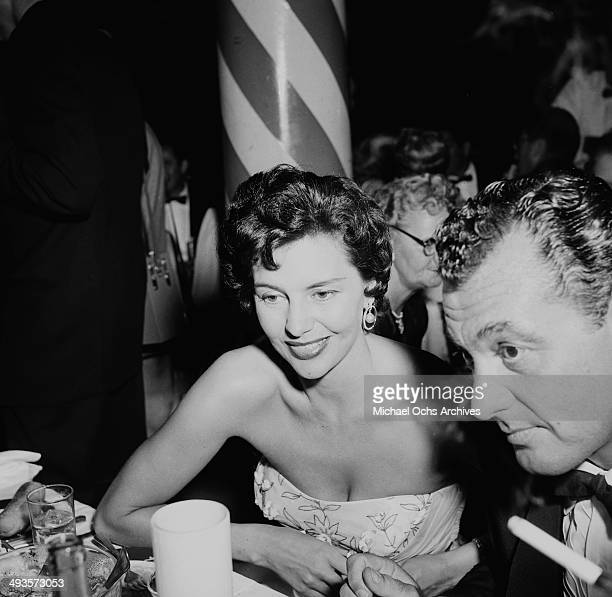 Actress Cyd Charisse with husband Tony Martin attend a party in Los Angeles California