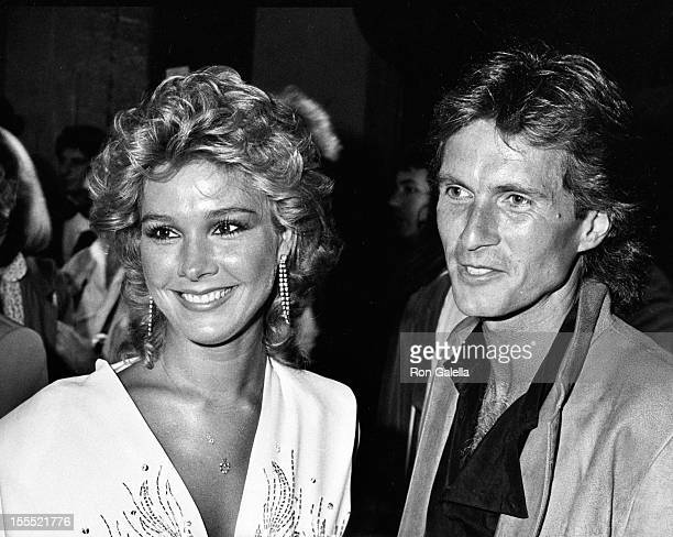 Actress Cynthia Rhodes and date attend the premiere of Stayin Alive on July 11 1983 at Mann Chinese Theater in Hollywood California