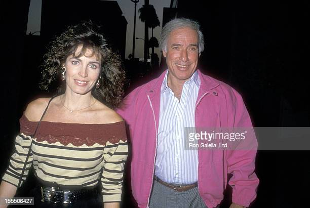 Actress Cynthia Sikes and director Bud Yorkin attend A Fish Called Wanda Beverly Hills Premiere on July 13 1988 at Academy Theatre in Beverly Hills...