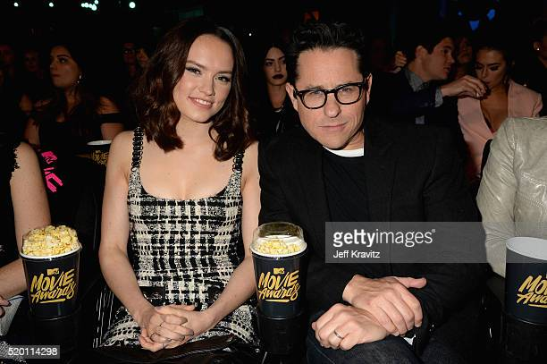Actress Daisy Ridley and director JJ Abrams attend the 2016 MTV Movie Awards at Warner Bros Studios on April 9 2016 in Burbank California MTV Movie...